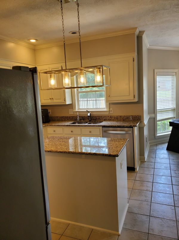 image of kitchen after renovation of Custom Fixture, Painted Cabinets, and countertops